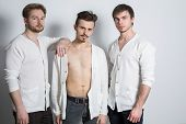 Three men in a white cardigan over his naked body in the studio