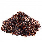 chipotle - jalapeno smoked chili pile isolated on white