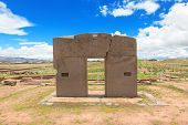 foto of megaliths  - Megalithic solid stone arch Gate of the Sun constructed by the ancient Tiwanaku culture - JPG