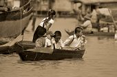 Unidentified children go to school on boat