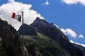 Italian Flag On Moutains