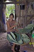 Filipino Woman Prepares Food