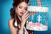 Romantic Girl Leaning Against On Vintage Bird Cages With Ornamental Decorations.