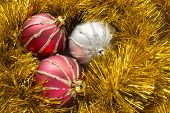 Three Christmas Balls In Tinsel