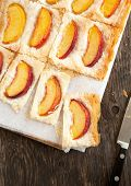 picture of phyllo dough  - Phyllo Tart With Sugared Peaches on wooden coking board - JPG