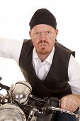 image of goatee  - A man on a motorcycle with a mean expression on his face - JPG