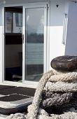 White boat open glass door bollard dock
