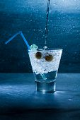 Gin Cocktail with crushed ice and olives