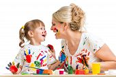 Mother With Kid Painting And Have Fun Pastime