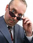 Serious Businessman Takes Sunglasses Off