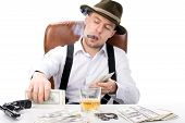stock photo of brass knuckles  - gangster sitting at a table counting money - JPG