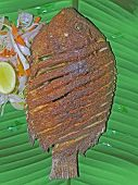 South Indian Thali (meals) With Fish Served Traditionally On Banana Leaf