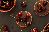 stock photo of tarts  - chocolate tart with cherry - JPG