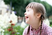 foto of playgroup  - Portrait of beautiful young girl smiling  - JPG