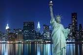stock photo of ladies night  - Midtown Manhattan Skyline and The Statue of Liberty at Night - JPG