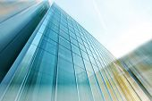 stock photo of building exterior  - Panoramic and perspective wide angle view to steel light blue background of glass highrise building skyscraper - JPG