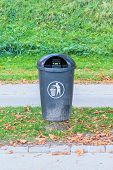 stock photo of dust-bin  - plastic dust bin on the road side of European city