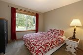 Bedroom With Red Bed And Brown Walls