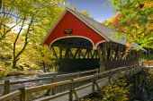 image of covered bridge  - New England covered bridge in fall season - JPG