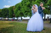 Russian wedding couple celebrates their marriage in a park