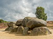 picture of megaliths  - Dramatic sky over megalithic stones in Drenthe Netherlands - JPG