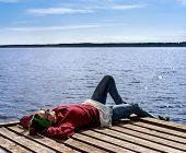 Woman Resting Near The Lake
