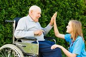 picture of nursing  - Playful doctor with patient at the nursing home - JPG