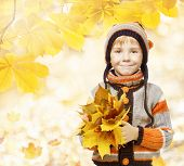 Autumn Kid In Leaves, Little Child In Woolen Hat, Knitted Clothing For October Season