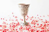 Silver Kiddush cup and Pomegranate seeds