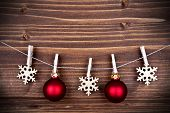 Christmas Decoration On A Line On Wooden Background