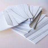 Pile of white post envelopes on a table