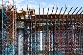 foto of trestle bridge  - Scaffolds at road construction site with sky background - JPG