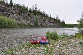 stock photo of ural mountains  - Tourist boat on the North taiga mountain river in the area of the Polar Urals - JPG