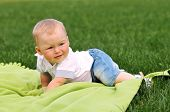 Little Boy On Green Blanket