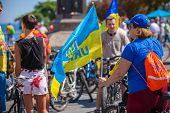ODESSA, UKRAINE - August 23: Flash mob in city of Odessa on Potemkin Stairs on August 23, 2014, in day of a national flag of Ukraine. Happy participants of summer Flash mob with a flag