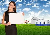 Businesswoman with landscape and industrial area