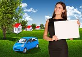 Businesswoman with car, landscape and houses