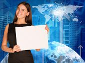 Businesswoman with  Earth, skyscrapers and world map