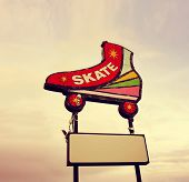 a skating neon sign toned with a vintage retro instagram filter effect