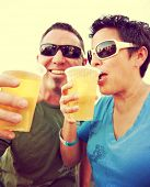 woman and a man celebrating over a fresh draft beer as their drink toned with a vintage retro style