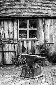 Black And White Landscape Of Old Blacksmiths Workshop In Victorian Times