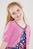 Portrait Of Happy Redhaired Caucasian Girl Wearing Polka Dotted Dress