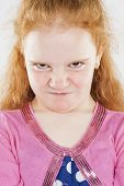 Portrait Of Angry And Furious Little Caucasian Redhaired Girl