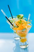 Fresh Orange and lime Mojito by the swimming pool