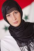 picture of arabic woman  - religious woman in kerchief over iraq flag - JPG