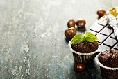 Chocolate muffins on wooden board - food and drink