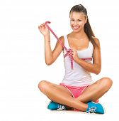 Sporty model Girl checking her breast measurement with a Measuring Tape Ribbon. Sport Girl Sitting,
