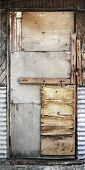 pic of shaky  - old shaky wooden patio door patched with plywood - JPG