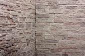 Decorative slate gray stone wall pattern, background.