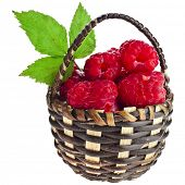 Raspberries in wicker basket isolated on white background